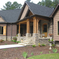 Traditional Exterior by Benchmark Construction Co., LLC