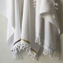 Turkish Tassel Hand Towel - Add plenty of tassels and fringe, even in the bath, for a bohemian home. I love these souk-inspired towels.
