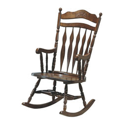 Monarch Specialties - Monarch Specialties Embossed Back Rocking Chair - Whether your are a new mom looking to sooth a baby or just want place to sit and relax, this country styled wooden rocking chair will be a lovely addition to your home. This high back rocker has a shaped top splat with detailed floral carvings and is finished in dark walnut. Soft curved arms frame the seat, with turned spindle supports. Turned legs above the wood rocker base complete this charming country style look and add the perfect touch of warm tradition. What's included: Rocking Chair (1).