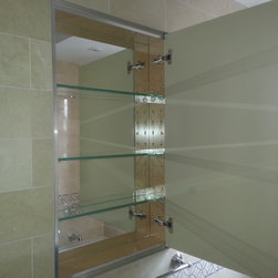 Klugman Residence - Custom made recessed medicine cabinet covered with on all sides of the door.