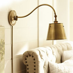 Walker Sconce, Antique Brass Finish - I love the curve of the bar on this perfect bedside light.