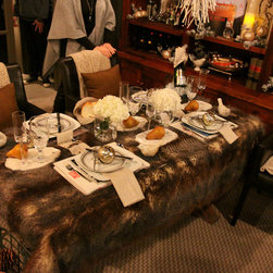 The Elements' Fall and Holiday Decorating Seminar - Why use a boring table cloth? We took this faux-fur throw and tossed it on a writing desk for an impromptu dinner in the library. The elegance of the tableware paired with the raw feel of the table covering combine textures and styles that are about as far apart on the spectrum as you can be! The Elements by K Sorbe