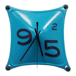 Working Class Studio - Charles Collection Clock - Teal - Time waits for no one — but it sure will pass pleasantly when you add this playful clock to your decor. Believe it or not, it's made of flexible silicone rubber, and its bright hue and random selection of numbers bring wit and whimsy to your wall.