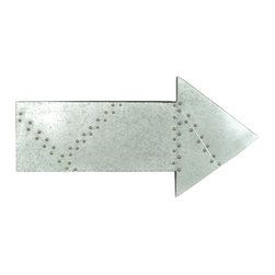 "Enchante Accessories Inc - Arrow Sign Metal Wall Decor / Wall Hanging / Wall Accent - Metal arrow hanging wall decor signMade from galvanized steel with exposed rivetsAged finish gives it an industrial lookPerfect for use in any home, office, or business Measures 32.3"" x 16"" x 2""Point the way with this decorative metal wall arrow sign from the Home Office Collection. The Arrow Sign Metal Wall D""cor / Wall Hanging / Wall Accent is made from galvanized steel and has an undeniably industrial look with exposed metal rivets that lend a vintage inspired quality to the design. Clean lines and smooth edges make this wall sign perfect for use in an industrial office space, a hip caf"" or bar, or a contemporary living space with a minimalist aesthetic. The silver finish is aged to perfection to give it the look of a found treasure or a repurposed piece of d""cor. This hanging wall accent can be used in just about any room or hallway in your home, office, or business. Use it to point the way to a restroom, hang it in a hallway to direct guests toward an exit or entrance, place it on a wall to call attention to a unique display in a store, or hang it as pure decoration in any room of the house. The sleek metal finish has a cool, modern look that adds a touch of industrial style to any space. Unique wall d""cor can personalize any workspace or living space and give it a fresh, modern look. For the decorator looking to create a one-of-a-kind wall display, this arrow sign can be hung in pairs pointing in different directions or mixed and matched with other wall signs, typography graphics, or photography prints in metal frames. This metal arrow sign can be hung on its own as a focal point in a living room or office or combined with other types of wall art to express your own personal style."