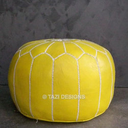 Yellow Moroccan Leather Poufs - Searching for that perfect pop of color in your otherwise neutral home? Look no further than this fabulous yellow leather pouf from Tazi Designs. Made of genuine leather, it's accented with beautiful white and yellow embroidery.