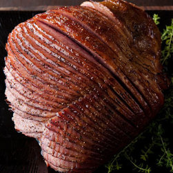 Horchow - Thyme & Honey-Glazed Ham - Ours exclusively. This delectable spiral-cut baked ham is glazed with a mixture of thyme, honey, and sugar for a wonderfully different taste. 7–8 pounds. Serves 12–15; approximately 6.4–9.6 ounces per serving. Perishable items are ship...