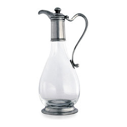 Pewter Classic Wine Decanter - From its knobbed cap to its banded-collar base, the design of the Pewter Classic Wine Decanter is just enough to feel well-appointed without drawing attention away from your other tableware or dry-bar selections. The pure metal accents on the teardrop-shaped glass bottle give traditional presence to a highly valued means of serving vintages at their best.