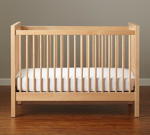 Andersen Crib, Maple - Cribs always strike me as looking a little severe, but I like this Andersen crib in soft maple from Land of Nod.