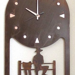 IronCraft - Cowboy on Fence Clock - -Handmade by skilled American craftspeople  -Rust finish  -Slight variations in color and dimensions will occur due to the handmade nature of the product  -During the finishing process each piece of steel develops its own unique pattern of light and dark tones and no two pieces are the same  -Lacquer coated to preserve the beautiful patina  -Clock runs on 1 AA battery, not included    -Made in USA IronCraft - 9855RU42