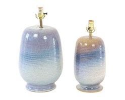 """Pre-owned Mid Century 1960s Beachy Blue Pottery Lamps - Pair - When you switch on this pair of lovely lamps, you can practically hear the crashing waves of the ocean! These rich, glazed pottery lamps are two different sizes, the larger lamp featuring blue tones and the smaller lamp featuring blues and beige. It's hard not to let the imagination drift away to a seaside sunset. Both lamps are newly rewired, dating back to the 1960s. Condition is good with normal wear due to age. Made of ceramic in the USA.    Large lamp: 6"""" dia. x 19� H  Small lamp: 6"""" dia. x 16� H"""