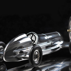 Thos. Baker - indianapolis car - Skilled enthusiasts of the 1930's loved to race the legendary B.B. Korn cars around the club tracks reaching incredible speeds. For the children of his clients, Mr Korn designed and built the Indianapolis a non powered pre-war give-away. Our Indy toy car pays homage to Korn's legacy with detailed dash, rubber tires, and a hand-polished aluminum body.�