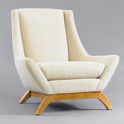 Jensen Chair - I'm crazy about DwellStudio's new furniture line. I'd love to put one of these chairs in the corner of the bedroom for hanging out and reading.