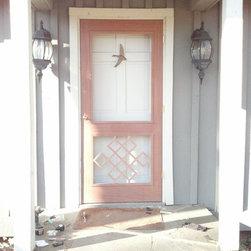 Legacy Chippendale Storm/Sceen Doors - Tibetian Knot Grill Solid Mahogany Storm/Screen Door - www.legacychippendaledoors.com