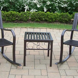 Oakland Living - 3-Pc Patio Rocker Set - Includes end table, two rocking chairs. Durable tubular iron construction. Metal hardware. Lightweight, fade, chip and crack resistant. Warranty: One year limited. Hammer tone bronze hardened powder coat finish for years of beauty. Minimal assembly required. Rocker chair: 23 in. W x 21.5 in. D x 34 in. H (33 lbs.). End table: 18 in. W x 18 in. D x 19 in. H (12 lbs.)The Oakland Rochester Collection combines practical designs and modern style giving you a rich addition to any outdoor setting. The traditional straight pattern work is crisp and stylish. Each piece is hand cast and finished for the highest quality possible. This rocker set will be a beautiful addition to your patio, balcony or outdoor entertainment area. Our rocking sets are perfect for any small space or to accent a larger space.