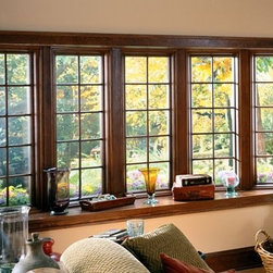Bay Windows - Bow windows with colonial grille pattern.