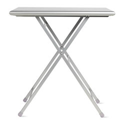 """Design Within Reach - Arc En Ciel Folding Table - Arc En Ciel, or """"rainbow"""" in French, is a small-space solution inspired by the chairs and tables that have filled Parisian parks and cafés since the 19th century. Weighing about 10 pounds, this durable, hardwearing Arc En Ciel Folding Table (2011) is produced with great attention to detail. The steel frame is finished with a baked-on polyester powdercoat that stands up to the elements and withstands being folded and unfolded as your flexible seating needs change. The Arc En Ciel folds completely flat for convenient storage, and is suitable for outdoor and contract use. From sidewalk café to city balcony to backyard patio, the Arc En Ciel is a well-priced solution for any outdoor dining need. Made in Italy. Only 2.5"""" thick when folded."""