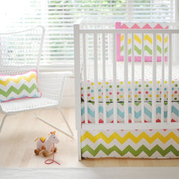 New Arrivals - New Arrivals Zig Zag Baby Crib Bedding Set - Rainbow Multicolor - CRIB2-ZZB RAIN - Shop for Bedding Sets from Hayneedle.com! Bright and colorful just like your little girl the New Arrivals Zig Zag Baby Crib Bedding Set Rainbow is sure to please both Mom and Baby. Made of soft 100% cotton this two-piece bedding set includes a crib skirt and sheet. Complete this crib bedding collection by adding the matching blanket and bumper (both optional). The bumper is dry clean only. The crib skirt features a colorful chevron design while the crib sheet displays a colorful array of polka dots. Each piece is to be cleaned by machine-washing on cold.About New Arrivals Inc.New Arrivals Inc. was started 15 years ago by mom-of-three Tori Swaim. What started as a small accessory and gift product line has grown into hundreds of products including bedding nursery and kids room decor letters and baby gifts. New Arrivals Inc. is your one-stop-shop for designing the baby nursery or kids room of your dreams.
