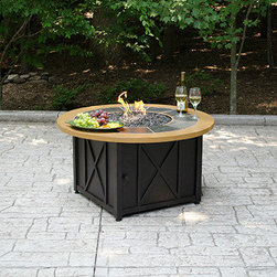 UniFlame Gas Circular Firebowl - Fire pits have evolved from caves and campsites to become a central part of modern day outdoor living.