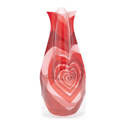 Modgy - Myvaz Expandable Flower Vase VenusDeModgy - Myvaz expandable flower vases do everything a glass vase does except collect dust, chip or break. Available in a variety of designs, myvaz expandable vases are durable and stable enough to hold a flower bouquet. These decorative vases expand with water and are ideal for events, weddings, and any table top. myvaz plastic vases are collapsible and economical, making it easy to keep a variety of colors and patterns tucked away for any occasion.