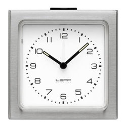 LEFF Amsterdam - Block Alarm Clock Arabic Dial by LEFF Amsterdam - Small and simple, yet strong and surprising. The LEFF Amsterdam Block Alarm Clock Arabic Dial is a petite alarm clock with a stainless steel case and easy-to-read Arabic style dial. It is even easy to read at night, with glowing fluorescent hands and a face that can be illuminated by pressing the snooze button. Less of the same, more of the different. That is the philosophy behind the modern clock designs created by LEFF Amsterdam. Founded by Arno Ruijzenaars and based in The Netherlands, LEFF reimagines the form and function of classic timepieces to tell time in new and bold ways. Once you have one of their clocks in your home, you'll definitely see how LEFF is more.