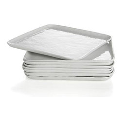 "Set of 8 Mercer Square Salad Plates - Contemporary porcelain whiteware represents a fusion of refinement and rusticity. Square slim profile takes on organic overtones with freeform rims and a finely ""hammered"" surface that ripples the light."