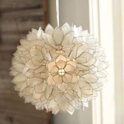Capiz Pendant | Pottery Barn - Okay, how gorgeous is this capiz-shell pendant? You'd never want it in the family room with Junior and his lightsaber, but in the bedroom? Perfection! The soft glow and even softer price will lull you into dreamland.