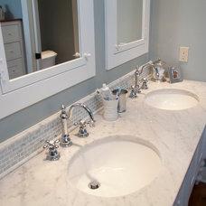 Farmhouse Bathroom by Jarrett Design, LLC