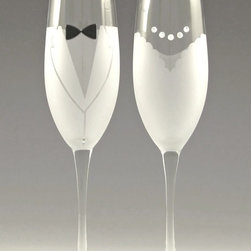 Asta Glass - Bride and Groom Champagne Flutes, Bride and Groom - Her scalloped-neck dress is permanently frosted onto the glass and is set off by a sparkling necklace made of Swarovski(R) crystals.  His Armani-inspired tux is also permanently frosted onto the glass. His bow tie is made of glass beads.  Sweet and romantic. A lovely way to toast the perfect day.