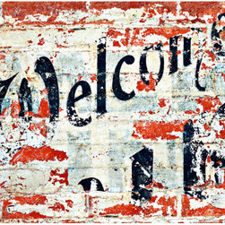 Welcome Wall Mural - A brick wall shows a faded welcome sign in this edgy 4-piece wall mural.