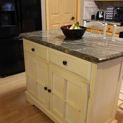 Granite Countertops with Durango Tile Backsplash ~ Medina, OH - In this kitchen update we installed a new Juparana Fantasy Granite countertop with a large beveled edge onto the existing cabinets with a Kohler undermount stainless steel sink.  We updated the hardware with Venetian Bronze knobs and handles. The backsplash is Tumbled Stone Durango 4x4 tile with Accent 1.25x1.25 Mosaic Pueblo with pencil round installed on the diagonal.