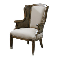 "Uttermost - Nessa High Back Wing Chair - High Back And Curvy Wings Make A Grand Statement In A Warm, Sun-washed Pecan Finish On Solid White Poplar With Cane Sides And Beige Faux Lambskin, Accented By Nickel Nail Head Trim And Metal Tips On The Grooved, Tapered Legs. Seat Height Is 18""."