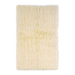 Linon - 5.6 ft. x 3.6 ft. New Flokati Rug in Natural - New Flokati Collection. Shag style. Rectangular in shape. Polypropylene warp with wool weft backing. 100% Wool. Hand woven in Greece. 5.6 ft. L x 3.6 ft. W (9 lbs.)There is only one real Flokati, and still today, Flokati is