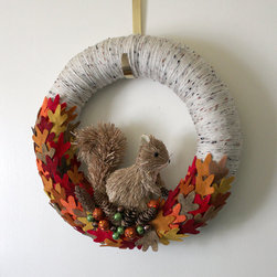Squirrel Wreath by The Baker's Daughter - I love the whimsical quality of this wreath. My girls would love to see it hanging on the front door.