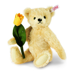 Tim Teddy Bear EAN 036767 - As winter fades, tulips herald the arrival of a new season. Cheery blossoms brighten your garden. Droplets of sparkling dew make the blooms even more beautiful in the morning. As you enjoy the sweet fragrance of the flowers, a bead of dew clings delicately to your cheek. Springtime is here at last!   Our designers have captured this moment of magic with Tim. Sewn from a rich, vanilla mohair, Tim holds a handmade felt tulip that looks fresh-picked from the garden. The SWAROVSKI ELEMENTS on the Teddy bear's nose and the tulip's petal simulate glistening drops of dew.   With our enchanting Tim Teddy bear, you'll add touch of spring to your collection in every month of the year.