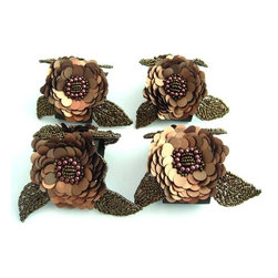 "Bronze Sequin Beaded Flower Napkin Rings Set of 4 - Create a luxurious table setting with these sophisticated napkin rings. Paillette-sequined and beaded floral appliques are applied to 1.5"" wide brown satin ribbon loops which wrap lavishly around each napkin.   Photo: MultiChic.com"