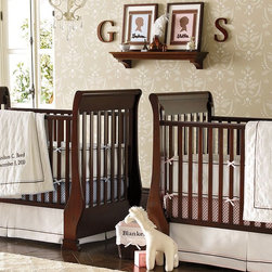Sleigh Fixed Gate Crib - This slick sleigh crib can provide a beautiful centerpiece for a classic nursery. Place the side or the head along the wall, or let it stand beautifully on its own in the middle of a room. A separate conversion kit changes this into a toddler bed for years of use.