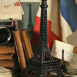 Cast Iron Eiffel Tower - Bring Paris into your home with the gorgeous Cast Iron Eiffel Tower. A delightful accent to place high on a shelf or on ones home office desk. For anyone that appreciates the magic of Paris�this item makes a thoughtfully lovely gift for any fellow Francophile.