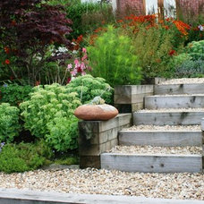 Beach Style  by Inspired Garden Design