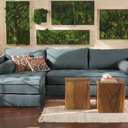 """Viva Terra - Eco Sectional in Solid Gray - Left Arm Chaise - We spent five years looking for a sectional that combined comfort, practical styling and eco-friendliness. Our search came to a satisfying end when we kicked back on this all-green, all-purpose rare find. First, the eco lowdown: Our manufacturer uses only certified sustainable wood frames and water-based wood finishes, recycled fiber filling in the pillows, and soy-based filling in the cushions. Upholstered in 100% linen ticking with tufted buttons - materials that are as durable as they are mindful - cover our sectional.Next, the comfort factor: We sat, we stretched and we were conquered - this is the curl-up sectional of all times. The frames are made from select kiln-dried hardwoods. Joints are double-doweled, and every corner is blocked, screwed and glued so that there are no creaks or sags.And the coup de grâce: The two cushions of our sectional (a one-armed couch plus chaise) are each the size of a twin mattress - remove the back pillows and sweet dreams are guaranteed. Made in USA. COUCH 79""""Wx42""""Dx32""""H, CHAISE 42""""Wx79""""Dx32""""H. Note: $150 shipping surcharge applies. Allow 8 weeks for delivery, see shipping info. IMPORTANT: when you are standing facing the sectional, a right-arm sectional has the chaise on the right and a left-arm has the chaise on the left."""