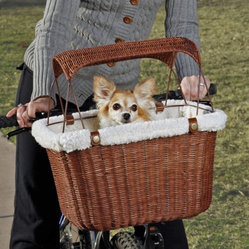 "Tagalong Wicker Bicycle Basket - Perfect for the pet owner on the go the Tagalong Wicker Bicycle Basket features a vintage look and traditional rattan construction. The wicker makes for a breathable design for your pet and an adjustable safety leash secures your pet while you are in transit. The custom sheepskin liner provides comfortable riding and can be taken out for cleaning. Keep away the bright sunlight with the sunshade or remove it when you want. With three-way adjustments this basket has a one-of-a-kind bracket system that will fit on any bike. It has a weight capacity of 13 pounds and measures 15L x 11W x 9.5H inches.About Solvit ProductsAt Solvit the motto is ""No pet left behind."" Offering a full line of ramps stairs strollers bicycle baskets trailers and other travel and mobility products Solvit considers the comfort of your four-legged friends. Your pets can travel with you with style and ease. Solvit products are designed to make life more comfortable and enjoyable for pets and their owners alike."