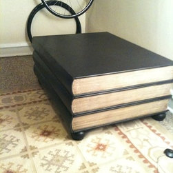 "Stacked Book Coffee Table - Coffee table shaped like three stacked books in great condition. The bottom two books are hidden drawers- that are lined with black felt. Coffee table is 18"" tall and the surface is 41″ × 31″. It has a black matte finish and the sides painted to look like book pages. This is a very sturdy piece of furniture. No delivery- pick up only near loyola in rogers park- asking price reduced to $150 obo. Cash!. :)"