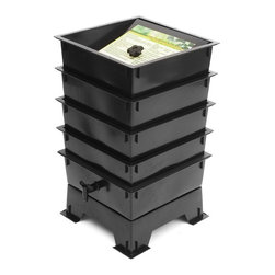 """The Worm Factory - The Worm Factory 4-Tray Recycled Plastic Worm Composter - Black - 4-TRAY BLACK - Shop for Garden Equipment from Hayneedle.com! The Worm Factory 4-Tray Recycled Plastic Worm Composter - Black is like a capsule hotel in Tokyo except the guests are 6 000 worms and it goes in your backyard. Made from 100% recycled plastic this composter allows worms to happily nosh 24/7 on your kitchen waste and whatnot providing you rich organic material. Odorless well-organized green and best of all the worms will eat your junk mail. Or bills. What is The Worm Factory and how does it work?Unique and ingenious the Worm Factory is composter comprised of stacking trays in which worms eat your scraps and leave behind rich organic material. Fill each tray with scraps like vegetables fruits egg shells coffee grounds paper and junk mail and in turn you'll get nutrient-rich compost for your garden. Worm castings are known to be the very best compost available. Your plants will thrive with this all-natural compost. Worms start in the bottom tray and work upward as they break down the waste. The worms leave behind the stuff and you don't even have to sort through the wiggly friends at all as they're already on the next tray up. Plus nutrient-rich moisture is captured in the collection tray and can be used as liquid fertilizer known as """"worm tea."""" What are the benefits of using The Worm Factory? It's Compact: It stacks instead of spreading out so if you're short on space no worries. The Worm Factory takes up a minimal amount of space. Odorless: With a smart ventilation lid and specific suggestions in the instruction manual The Worm Factory remains odorless as it works tirelessly to create rich organic material. So breathe easy! Easy to Manage: The trays are lightweight and easy to stack and move and the accompanying instruction manual is chock full of suggestions to make composting easy and seamless. Saves Time: Forget running out to your composter to tumble and turn it! Let t"""