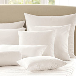 Feather-Down Blend Pillow Inserts - If you don't have room in your budget for a headboard, purchase two Euro pillows to create the illusion of one.
