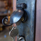 Custom Doors - This hand forged iron lock sets enhances any of our doors and keeps the handcrafted feel of everything. If you have any questions or would like to order give us a call.