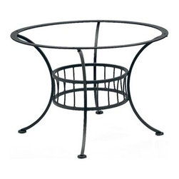 Woodard - Woodard Easton Wrought Iron Chat Table Base Only - The Woodard Easton furniture collection is a design lesson in the effective use of arcs and angles. Its expressive use of geometric figures � made of durable wrought iron no less � is the creative handiwork of Woodard�s master artisans. Each piece includes many subtle upscale details that let you know that this set will give you complete satisfaction for years to come. Look at the symmetry and precision in the wrought iron chair backs the table bases and Easton wrought iron patio loveseat. You won�t find this level of workmanship in other manufacturers� outdoor patio furniture.With the Easton furniture collection you have free range to customize your set from the powder coated rust-fighting finishes on the frames to the standard and designer fabric options including trim detail and chair ties in more than 30 colors and design choices. If you have other outdoor furniture for example a patio furniture glider from another maker you can get a replacement cushion for it and blend it in with the Easton furniture pieces you select.The name Woodard Furniture has been synonymous with fine outdoor and patio furniture since the 1930s continuing the company�s furniture craftsmanship dating back over 140 years. Woodard began producing hand-made wrought iron furniture which led the company into cast and tubular aluminum furniture production over the years.� Most recently Woodard patio furniture launched its entry into the all-weather wicker furniture market with All Seasons which is expertly crafted and woven using synthetic wicker supported by an aluminum frame.� The company is widely known for durable beautiful designs that provide attractive and comfortable outdoor living environments.� Its hand-crafted technique used to create the intricate design patterns on its wrought iron furniture have been handed down from generation to generation -- a hallmark of quality unmatched in the furniture industry today. With deep seating slings and metal seating options in a variety of styles Woodard Furniture offers the designs you want with the quality you expect.  Woodard aluminum furniture is distinguished by the purest aluminum used in the manufacturing process resulting in an extremely strong durable product which still can be formed into flowing shapes and forms.� The company prides itself on the fusion of durability and beauty in its aluminum furniture offerings. Finishes on Woodard outdoor furniture items are attuned to traditional and modern design sensibilities. Nineteen standard frame finishes and nineteen premium finishes combined with more than 150 fabric options give consumers countless options to design their own dream outdoor space. Woodard is also the exclusive manufacturer of outdoor furnishings designed by Joe Ruggiero home decor TV personality.� The Ruggiero line includes wrought iron aluminum and all weather wicker designs possessing a modern aesthetic and fashion-forward styling inspired by traditional Woodard patio furniture designs. Rounding out Woodard�s offerings is a line of distinctive umbrellas umbrella bases and outdoor accessories.� These offerings are an integral part of creating a complete outdoor living environment and include outdoor lighting and wall mounted or free standing architectural elements � all made with Woodard�s unstinting attention to detail and all weather durability. Woodard outdoor furniture is an American company headquartered in Coppell Texas with a manufacturing facility in Owosso Michigan.� Its brands are known under the names of Woodard Woodard Landgrave and Woodard Lyon Shaw. With a variety of collections Woodard produces a wide array of collections that will be sure to suit any taste ranging from traditional to contemporary and add comfort and style to any outdoor living space. With designs materials and construction that far surpass the industry standards Woodard Patio Furniture creates beauty and durability that is unparalleled.