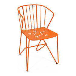 7100 Armchair by Fermob - Things charming chair comes in an array of bright colors and is suitable for both indoor and outdoor use.