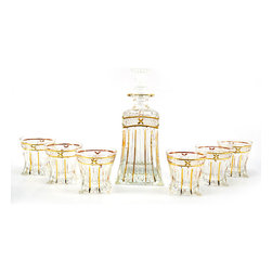 None - Seven-Piece Clear Glass Bottle and Shot Glass Liquor Set - Manufactured to the highest quality, this stylish and innovative liquor set is a real crowd pleaser. This set features goldtone edging on each of the six shot glasses and the larger bottle.