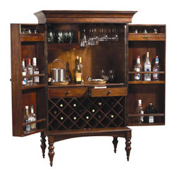 Howard Miller - Howard Miller Cherry Hill Hide A Home Bar - Howard Miller - Home Bars - 695014 - This traditional hide a bar is well-heeled in Victorian style for your dining area with the convenience of a space-consciously designed cabinet that nonetheless offers ample storage capacity. Elegantly appointed with it's broadly molded crown carved legs and herringbone-cane cabinet paneling the Cherry Hill features four interior shelves able to safely retain up to sixteen bottles and two top shelves for any and all accessories you deem necessary. A stemware rack for glasses and a rich trade winds cherry finish complete the look and appeal of the Cherry Hill Hide A Bar.