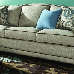 Chelsea Home - Cornell Sofa - Includes two 18 in. accent pillows and one 16 in. blue accent pillow. Patented seating unit equal to frame within a frame construction. Seating comfort: Medium. Kiln-dried fortress frame construction. Acorn legs provides extra durability. 0.88 in. hardwood arms are attached. Insulated power fasteners and covered. Heavyweight cardboard to shape curves. No seat cushion attached. Seat back cushion is attached. Seat cushion is reversible. Heavy duty sinuous back springs spaced closely together for maximum back support and comfort. Heavier gauge coils around the perimeter of the drop in coil unit for support and balanced seating. Machine tied drop in coil unit. Constructed of pocketed coils to provide support. 2.0 HD high resiliency foam. Sewn in channels for maximum shape retention and support. Made from 69% polypropylene, 31% polyester and solid Kiln-dried hardwood. Golden shoal sand color. Made in USA. No assembly required. Seat height: 22 in.. Seat depth: 20 in.. Seat width: 67 in.. Overall: 84 in. L x 39 in. W x 39 in. H (163 lbs.)