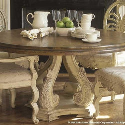 "Habersham - Habersham Biltmore Valencia 54 Round Dining Table - It all started in the small North Georgia town of Clarkesville. It was 1969 and Habersham founder Joyce Eddy had just been given the chance to operate a small antique shop located above an old laundromat. This was just the opportunity a woman of Joyce's vision and energy would turn into the perfect blend of utility artistry and soul. Looking for ways to make her antique business more profitable she began crafting small decorative purses from vintage wooden cigar boxes. They were totally unique and they were an instant hit. Joyce named her new venture Habersham Plantation after Georgia's Habersham County and the plantations for which the area was known. The ideas just kept coming. One day Joyce was driving by a local textile company and spotted a large pile of old discarded wooden spools. Those spools were soon crafted into candleholders towel racks and folk art items. With the help of her sons and other family members Joyce expanded Habersham's offerings to include handcrafted furniture reflecting the American Country designs of the early 17th and 18th centuries. As word spread and production demands grew Joyce enlisted the help of woodworkers from her North Georgia region. This area had been a center for cabinetmaking since the early 1800s and the master craftsmen were well-schooled in the time-tested woodworking and joinery techniques that matched Joyce's sense of style and function. She even designed her factory to work just as the 18th century cabinetmakers did with individual artisans hand-finishing signing and dating each piece of furniture they crafted. Today Habersham still leads the way in the fine art of furniture design. So much so that in addition to their product line a new ""whole home"" concept is finding its way into some of the finest dwellings in the country. Custom kitchen bath and other cabinetry designs offer rich opulent finishes and blend seamlessly with rooms of casual elegance all enhancing today's gracious lifestyle."